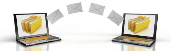 Depiction of envelop transferring from one laptop computer to another.